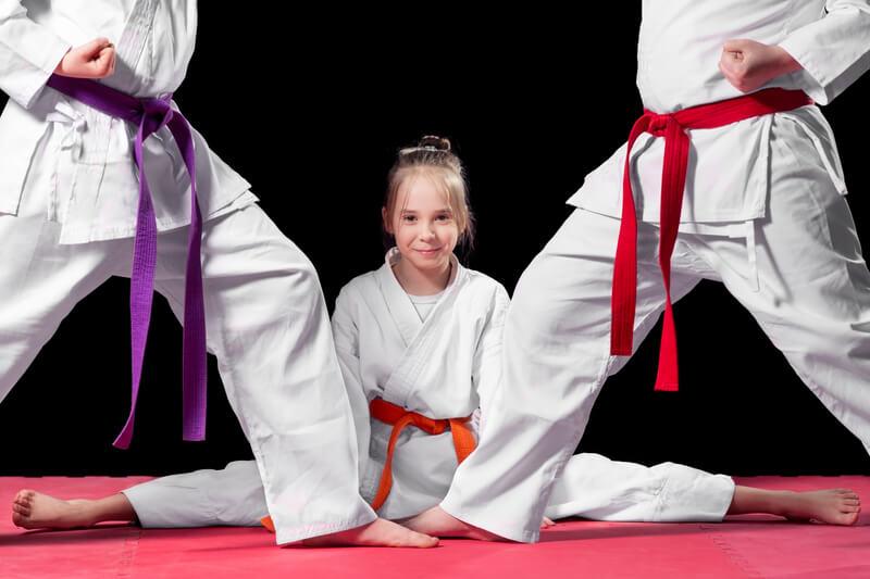 Martial Arts Students on Mat_splits